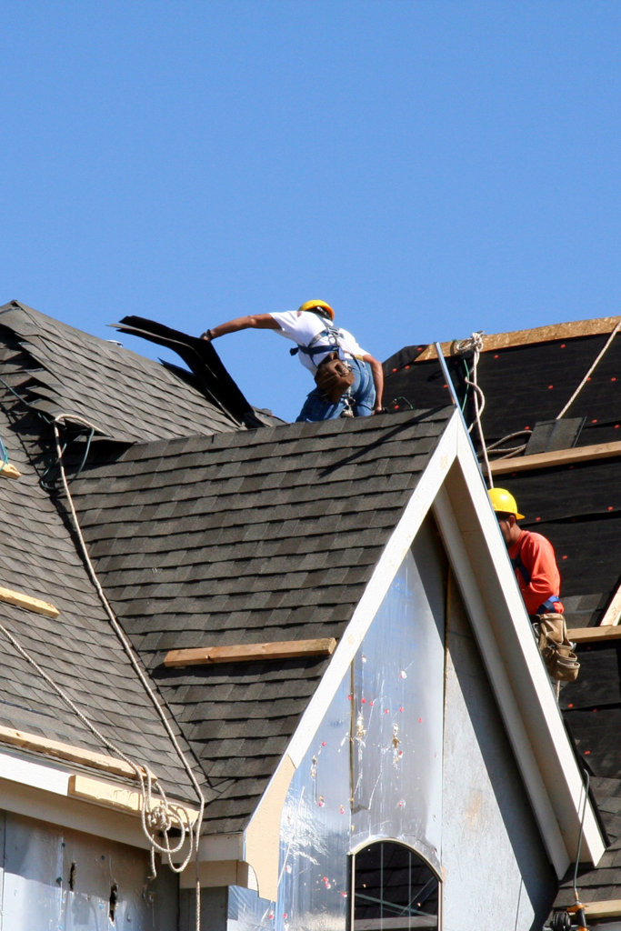 DRS roofers putting on new shingles